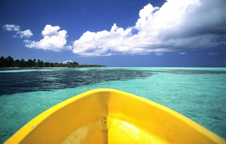 Yellow boat in light blue sea.Sanoa island.Parque Nacional del Este.East National Park.Dominican Republican
